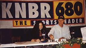Andrea with Rick Barry, sharing her thoughts with KNBR listeners